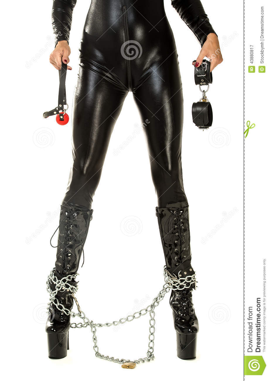 ... In Latex Suit Holding With Handcuffs Stock Photo - Image: 43880817