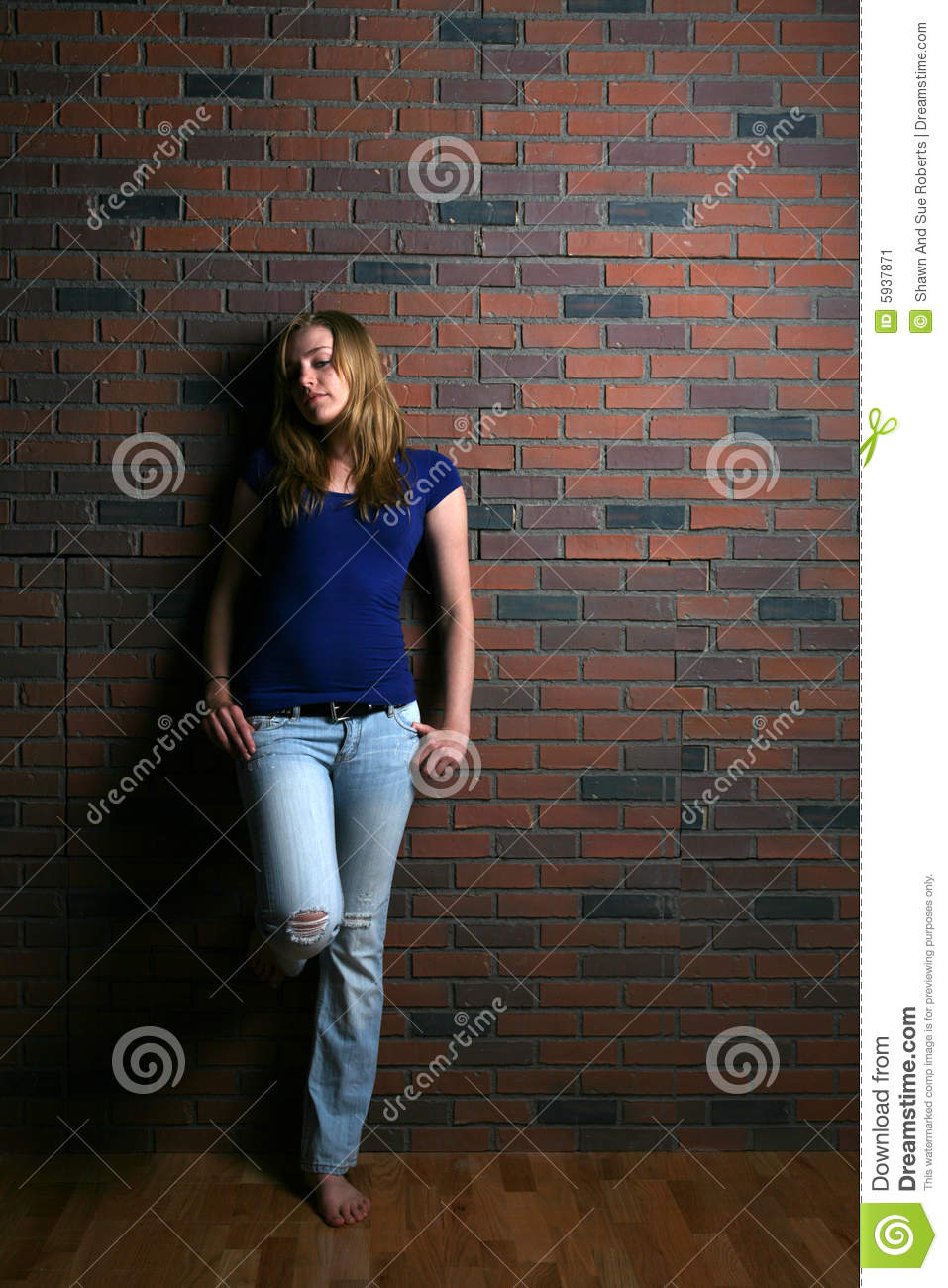 Woman Leaning Against Brick Wall Stock Image Image Of