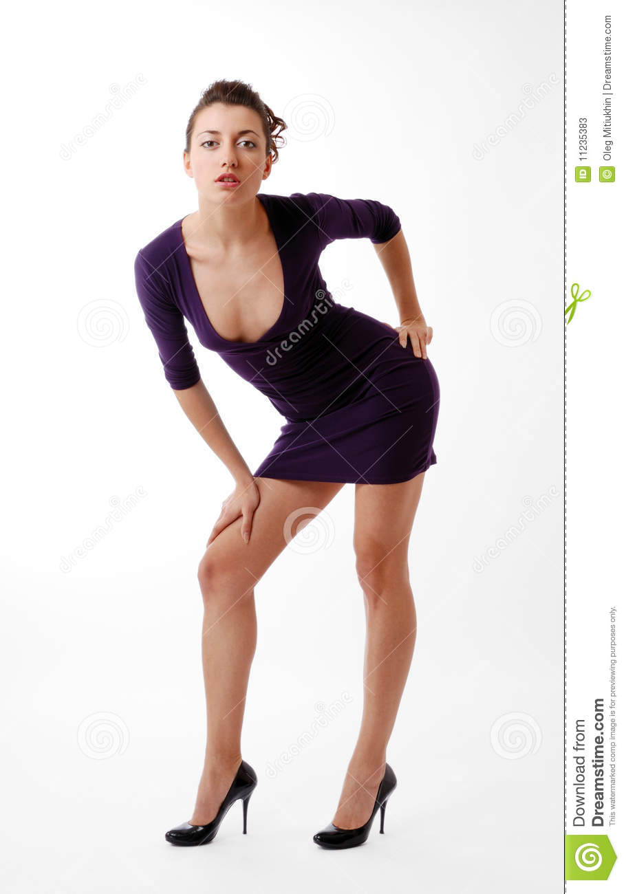 Woman Leaning Over In Skinny Dress With Decollete Stock ...
