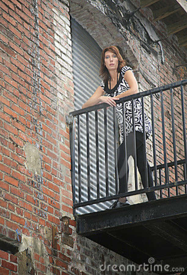 woman leaning on the rail stock image image 7730521