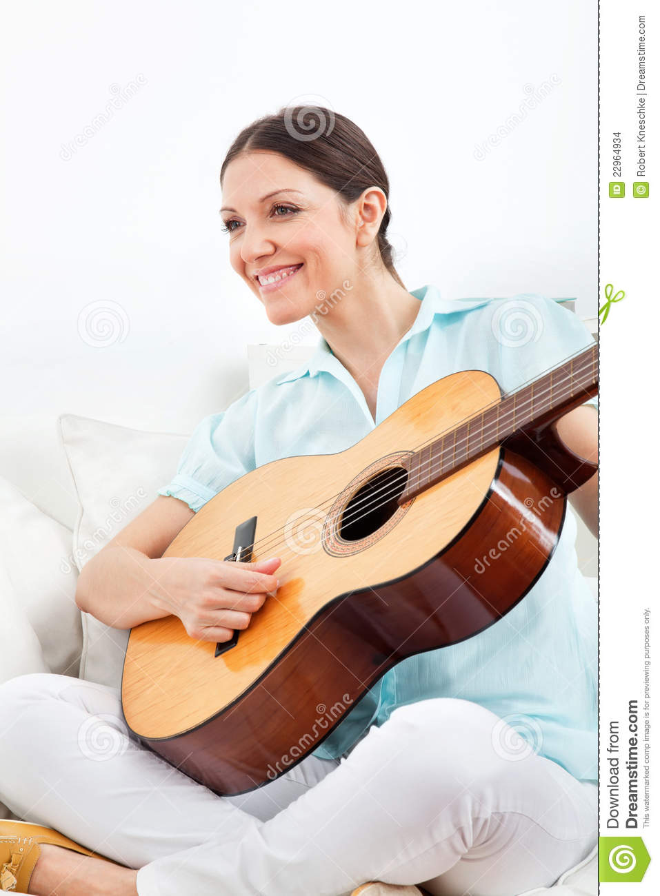 woman learning to play guitar stock photo image of happy people 22964934. Black Bedroom Furniture Sets. Home Design Ideas