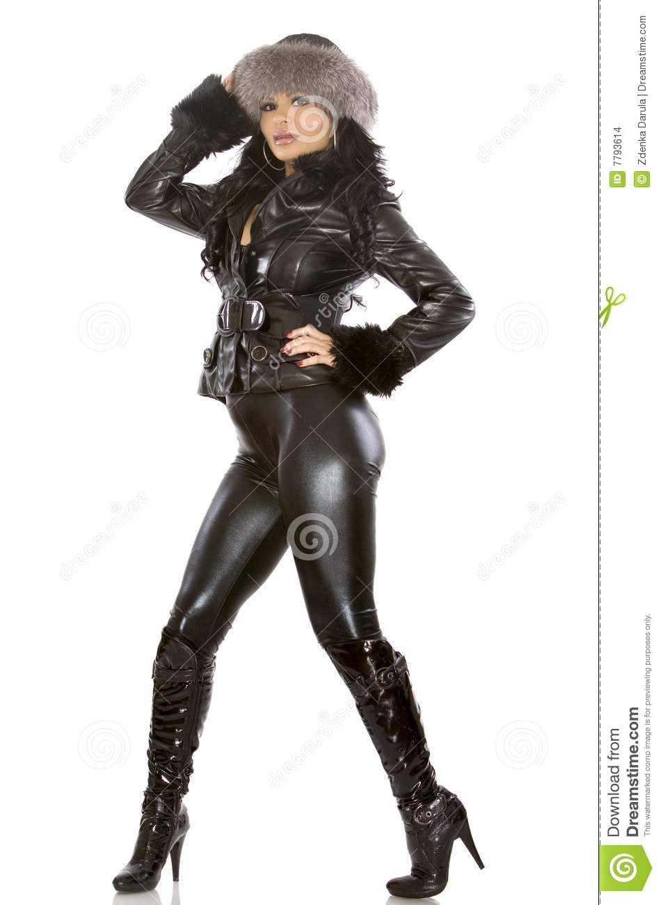 Pretty model wearing leather outfit on white background.