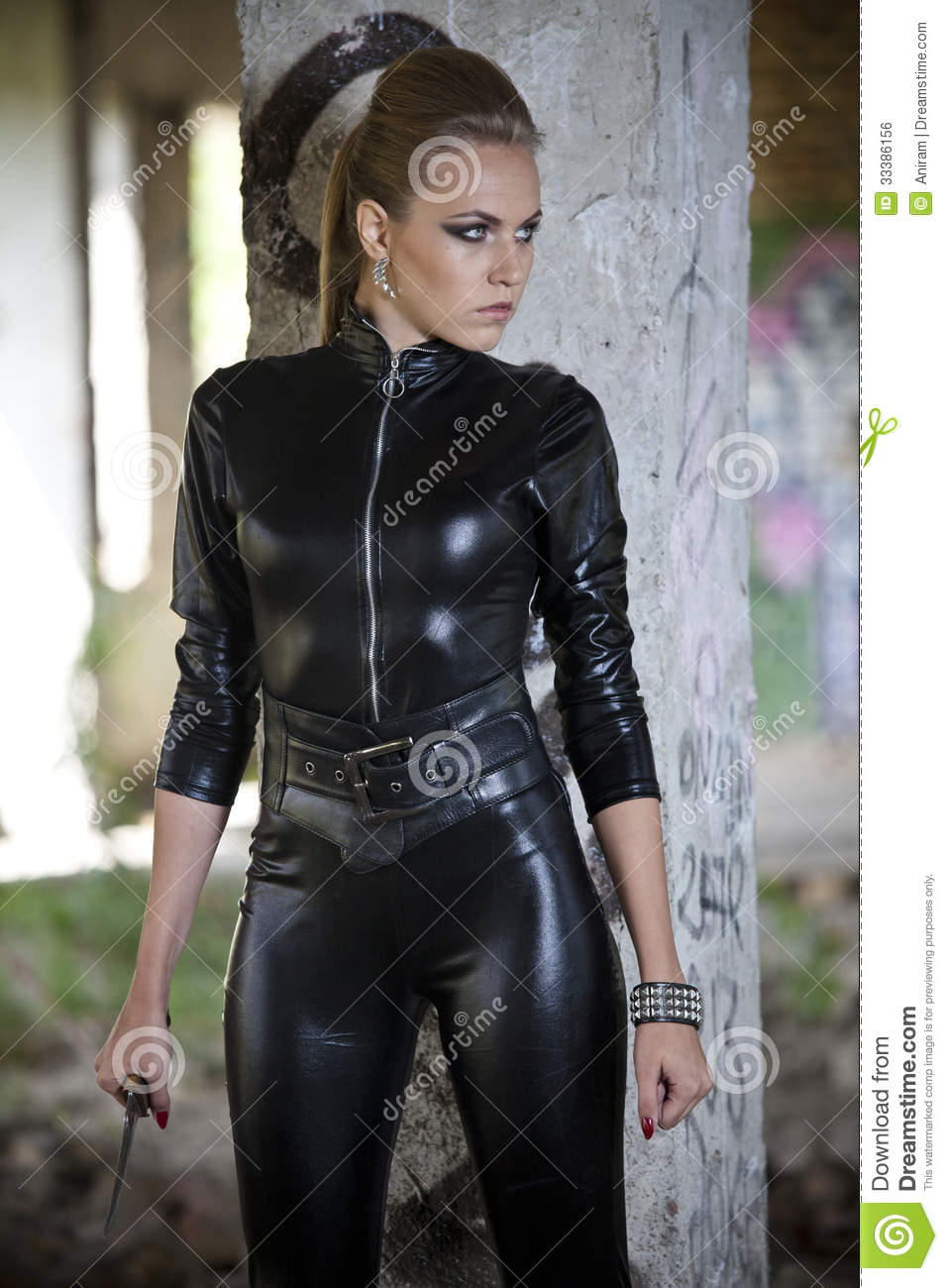 Woman In Leather Dress With Knife Royalty Free Stock Image - Image ...