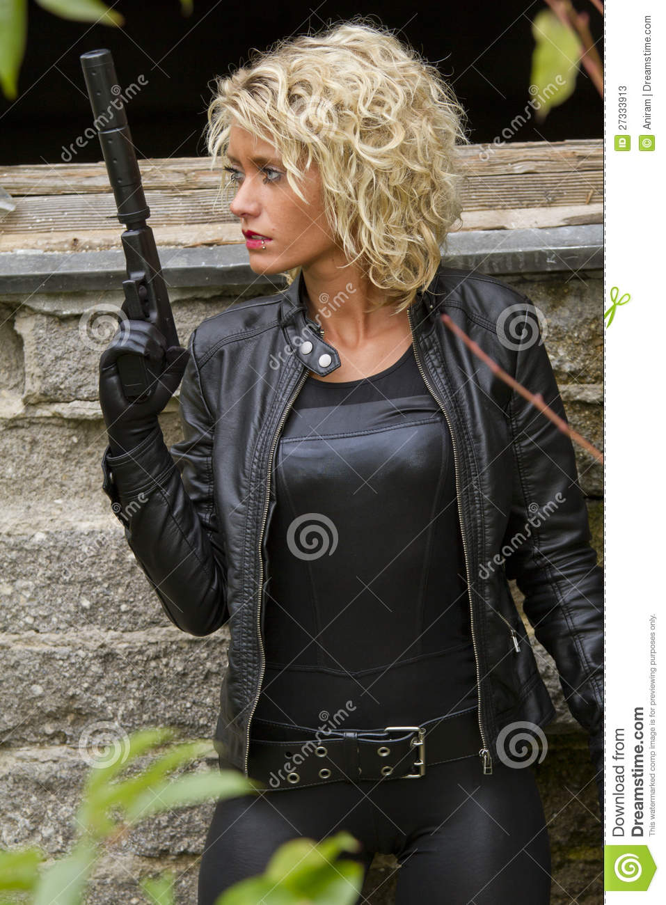 Ladies leather shooting gloves - Woman In Leather Catsuit And Gloves With A Silencer Gun Outdoor