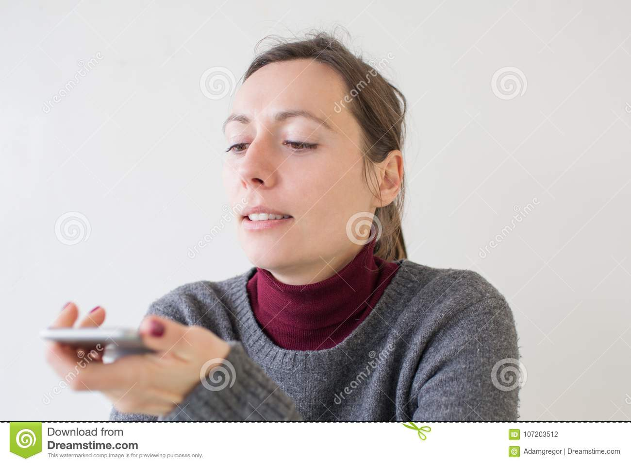 Woman leaving a voice massage on the phone