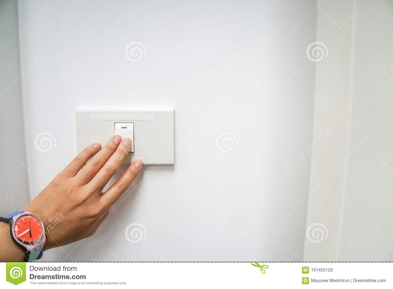 Woman left hand with cute watch turn off the office light switch for energy savings