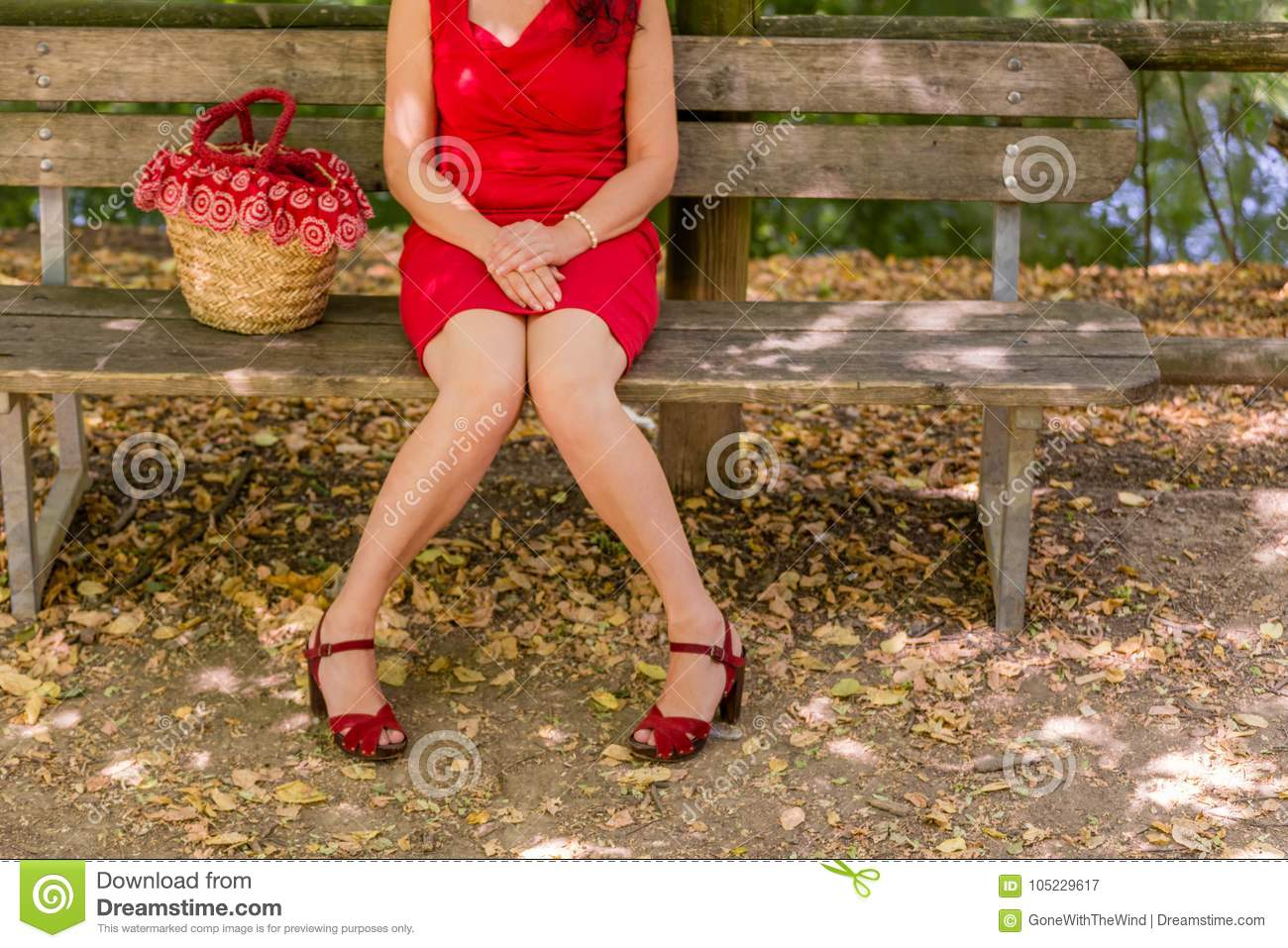 Woman with legs apart and keeping knees in touch