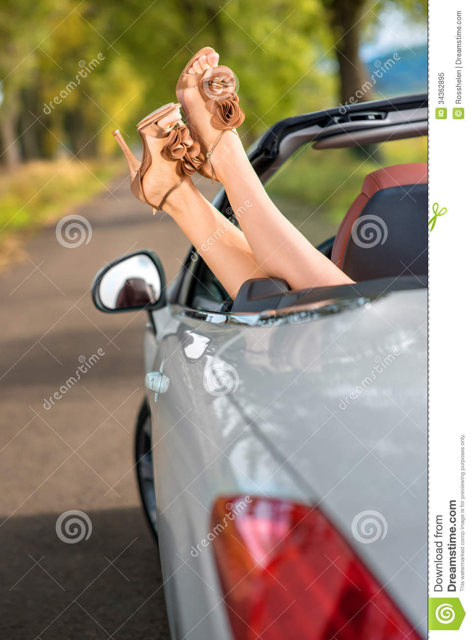 Woman legs in car