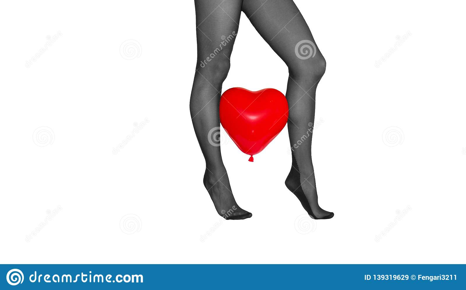 91314381f3862 Woman legs on the toes in black tights with red heart baloon between on  white background