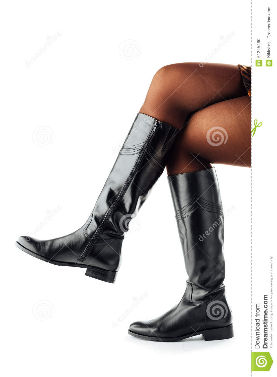 legs wearing black leather high boots stock photo