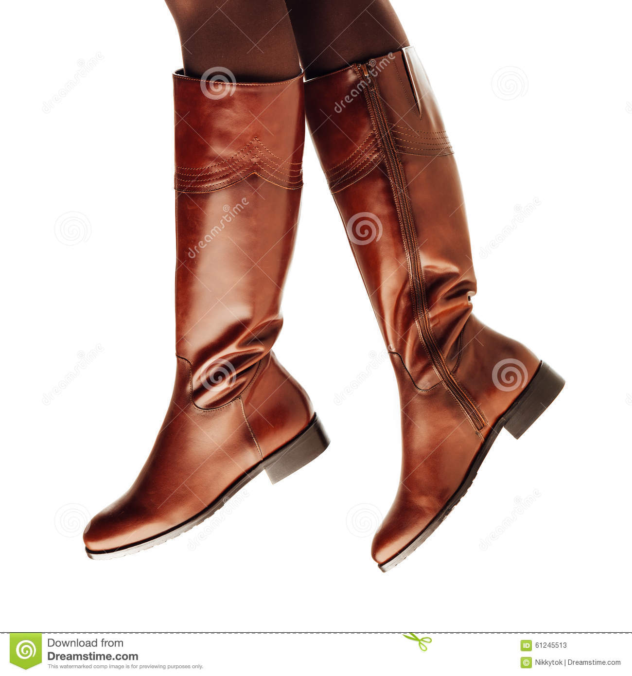 legs wearing brown leather high boots stock photo