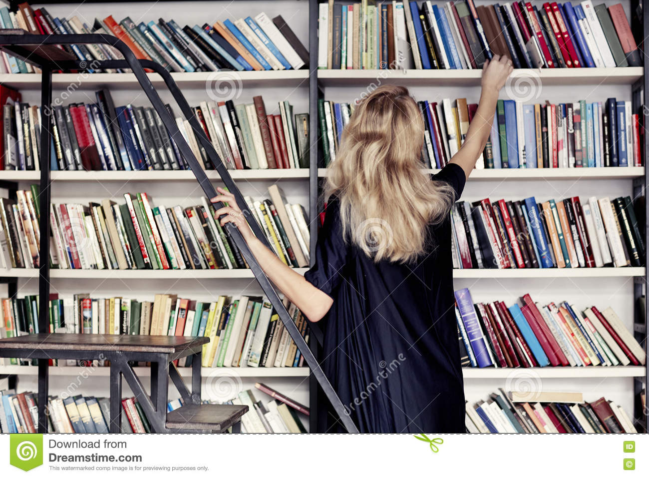 Woman In A Library Take Book From Bookshelf Download Preview