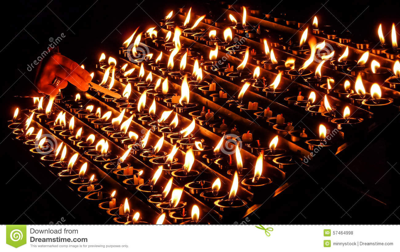Woman lighting prayer candle in a church & Woman Lighting Prayer Candle In A Church Stock Photo - Image of hand ...