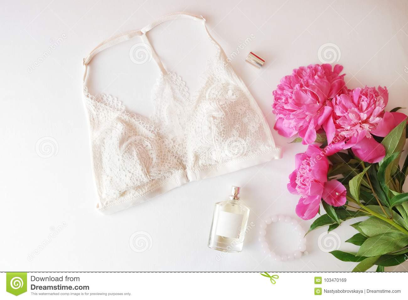 f348fc386b51 Woman clothes and accessories: pink top, jeans skirt, perfume, sandals,  sunglasses, hat, lipstick on white background. Flat lay trendy fashion  feminine ...