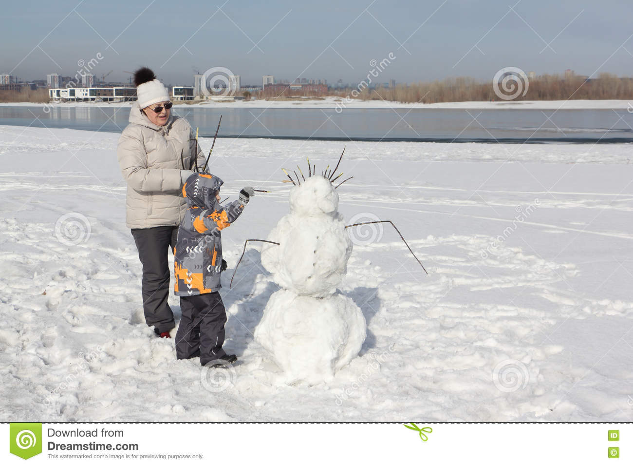 The woman and the little boy building a snowman stock photo royalty free stock photo buycottarizona Images