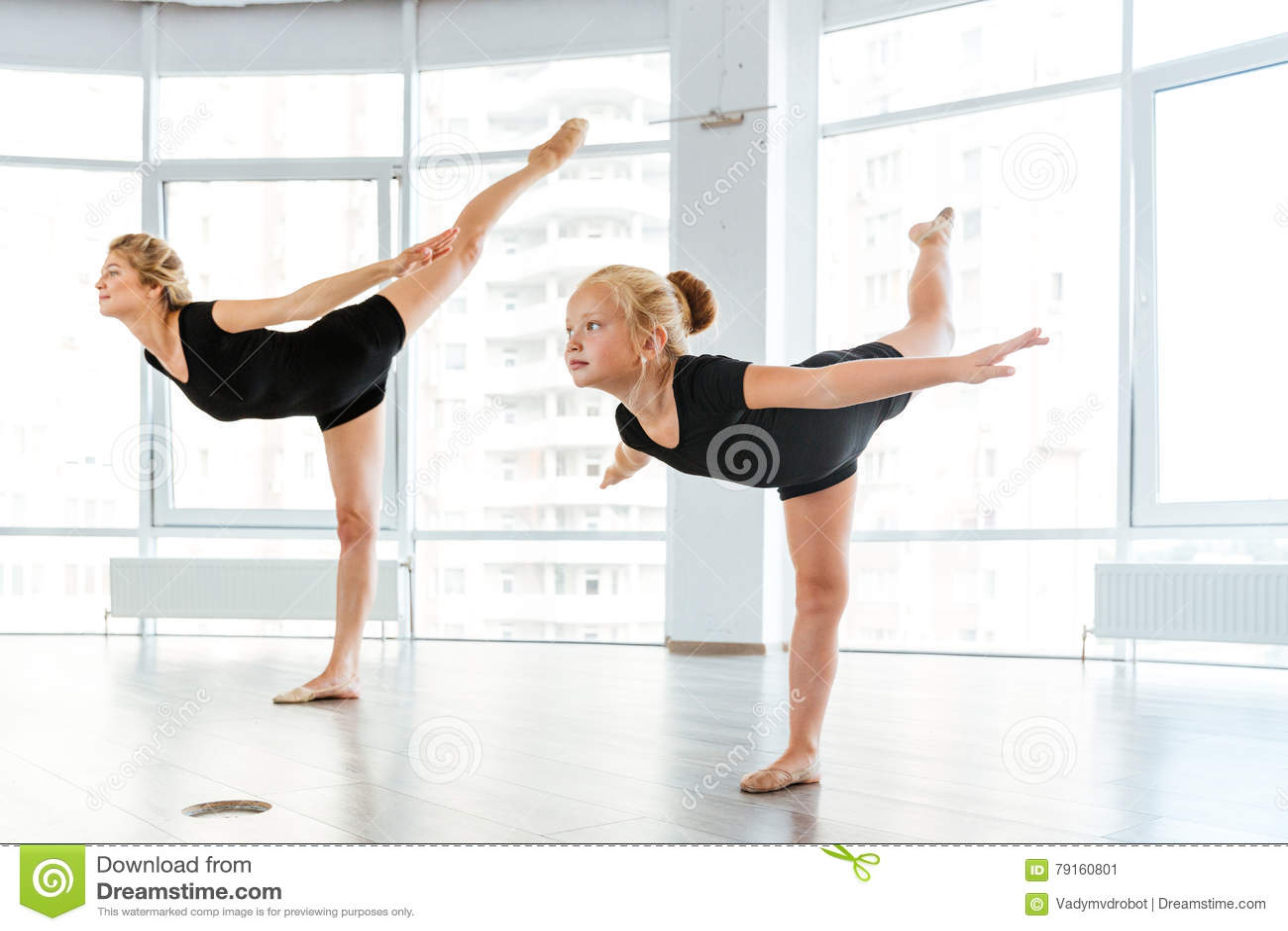 Woman And Little Girl Ballerina Dancing In Ballet School ...