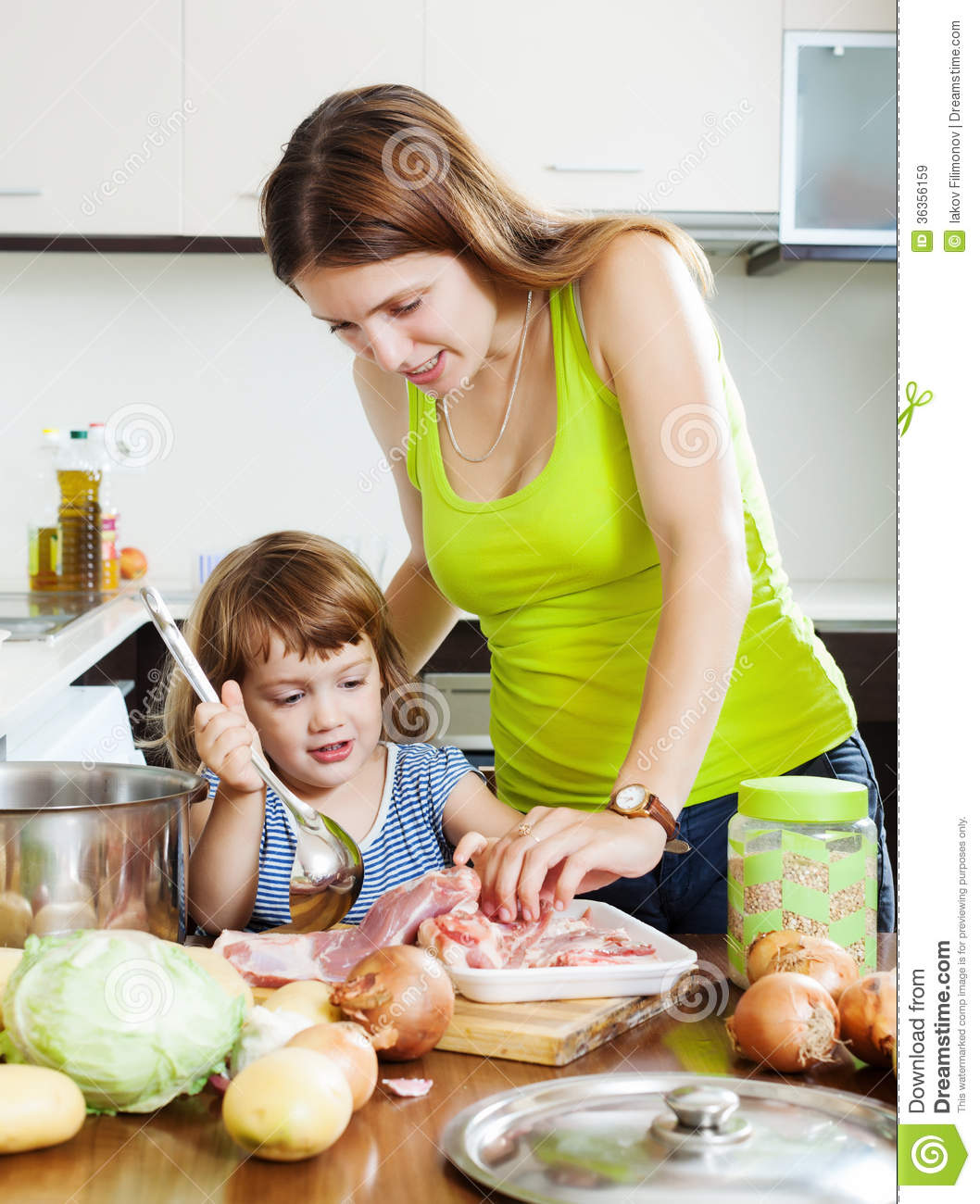 Woman with little girl cooking at kitchen stock image image 36356159 - Home cooking ...