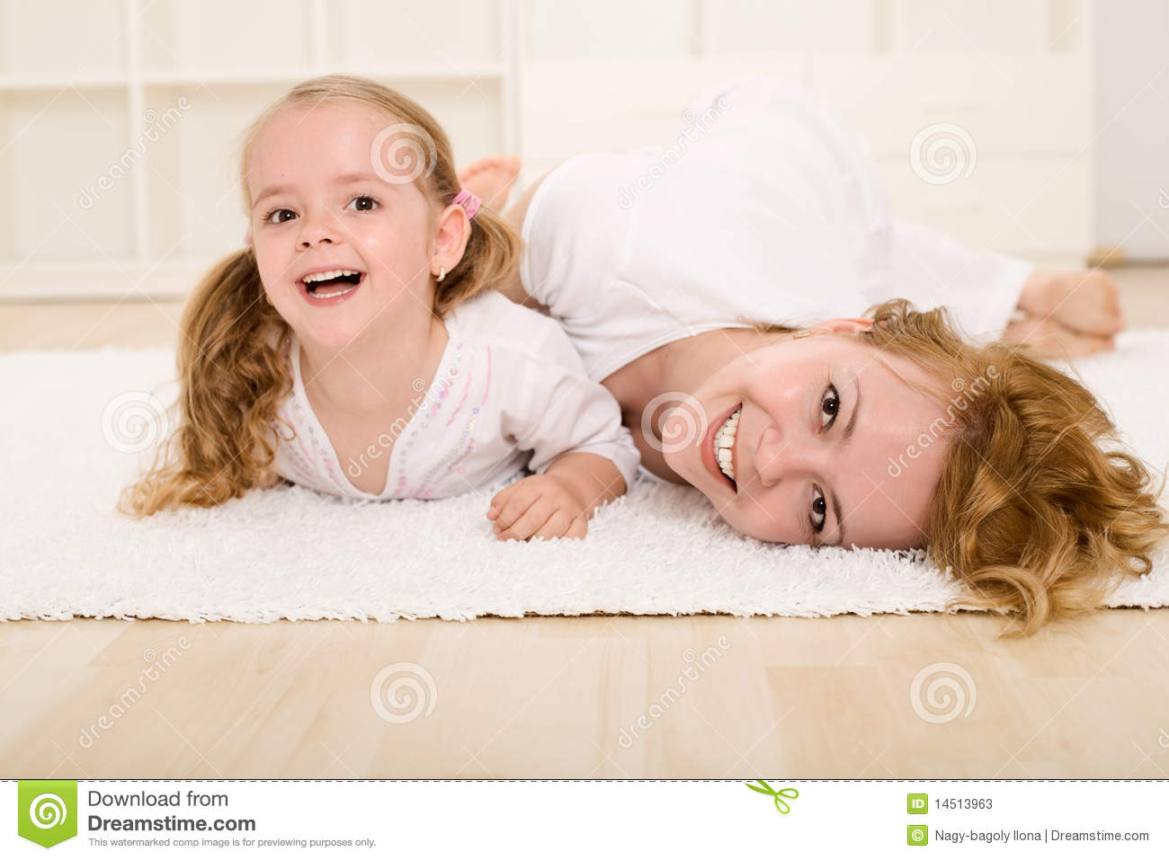 Woman and little girl playing and having fun