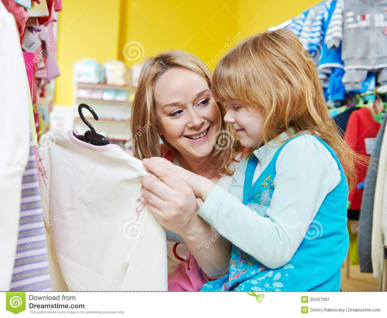 Woman And Little Girl Shopping Clothes Stock Image - Image: 35437091
