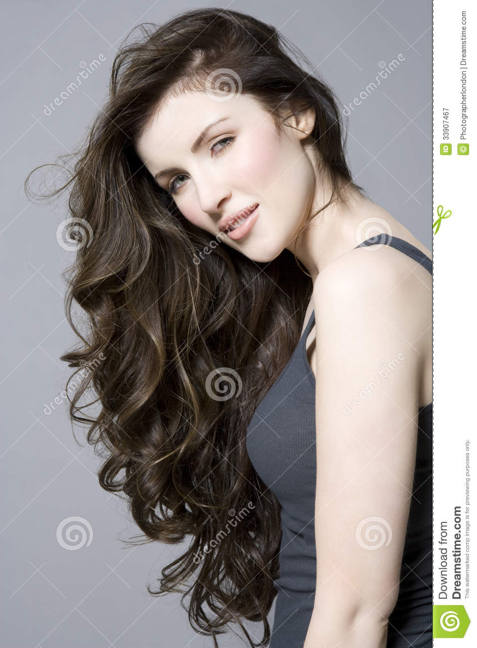 Woman With Long Brown Wavy Hair Royalty Free Stock Photography - Wavy hair