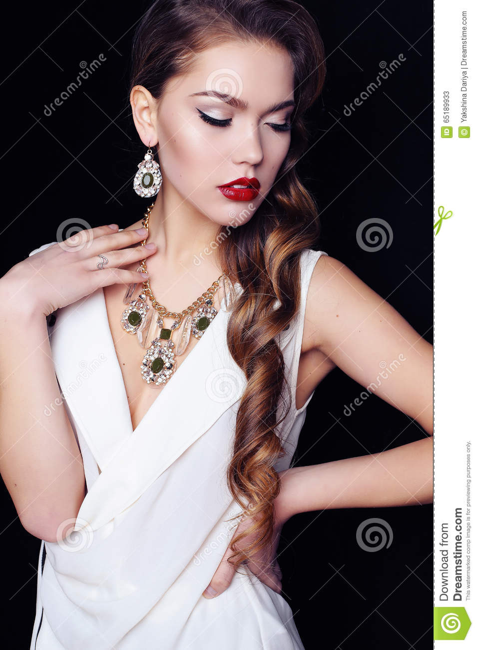 765c6c3964b Fashion interior photo of gorgeous woman with long dark curly hair wears  luxurious necklace and elegant dress