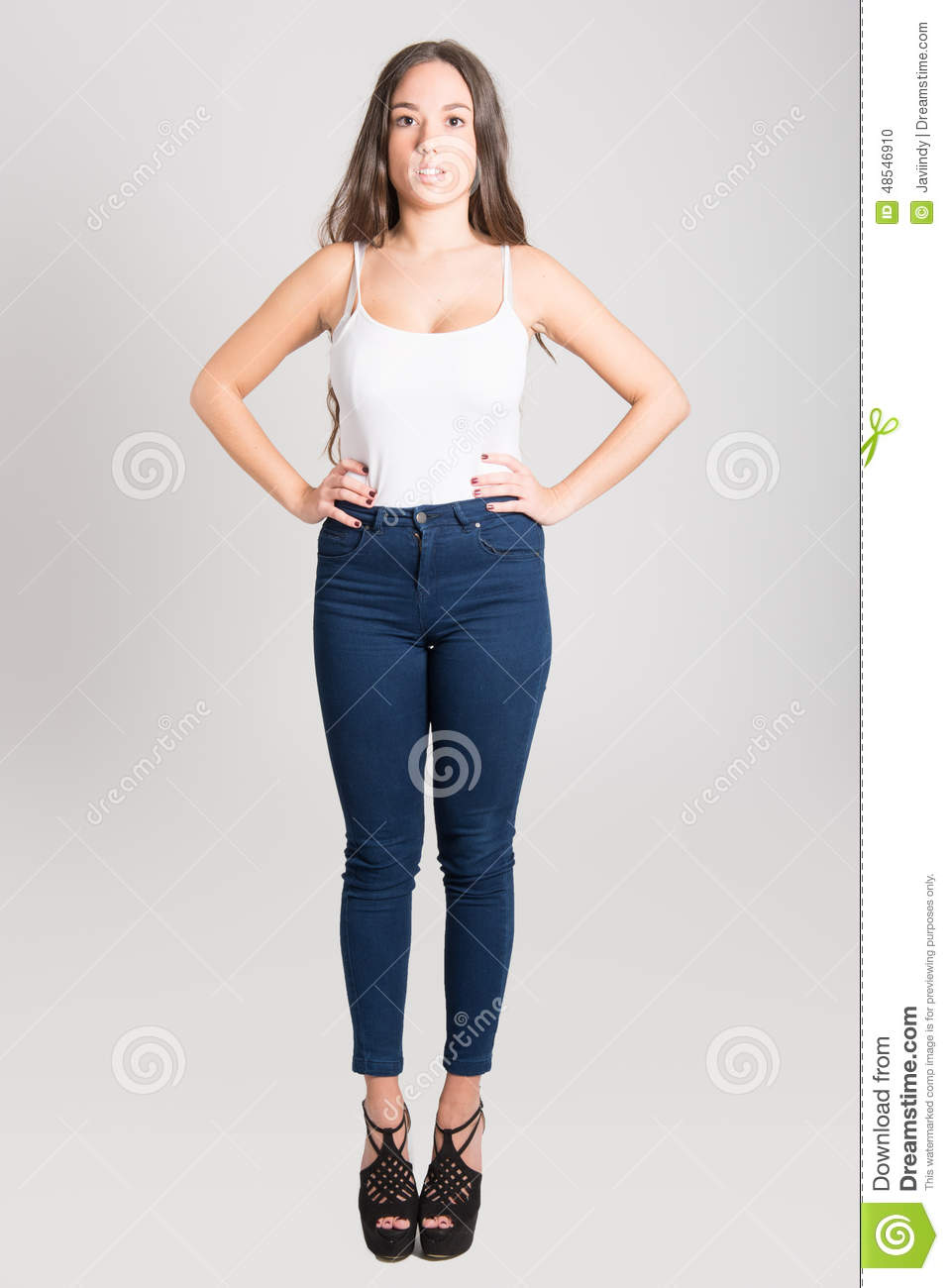 Woman With Long Hair Wearing White T-shirt And Blue Jeans Stock Photo - Image 48546910