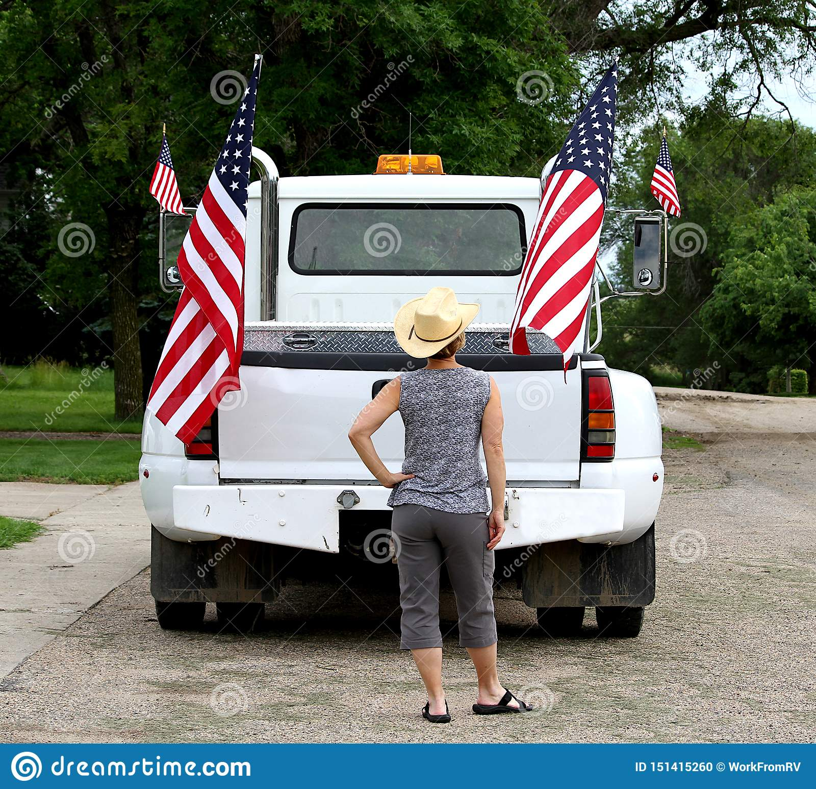 A Woman Looking At American Flags Displayed On A Pickup Truck Stock Photo Image Of Summer Patriotism 151415260