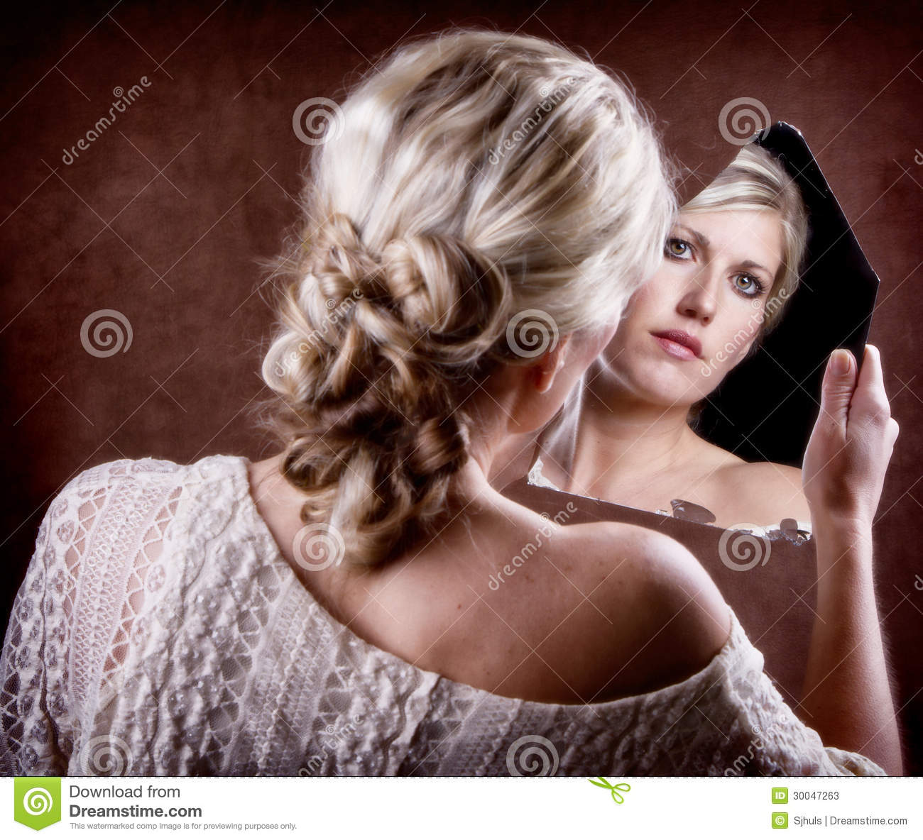 Woman Looking Into A Broken Mirror Stock Photos - Image: 30047263