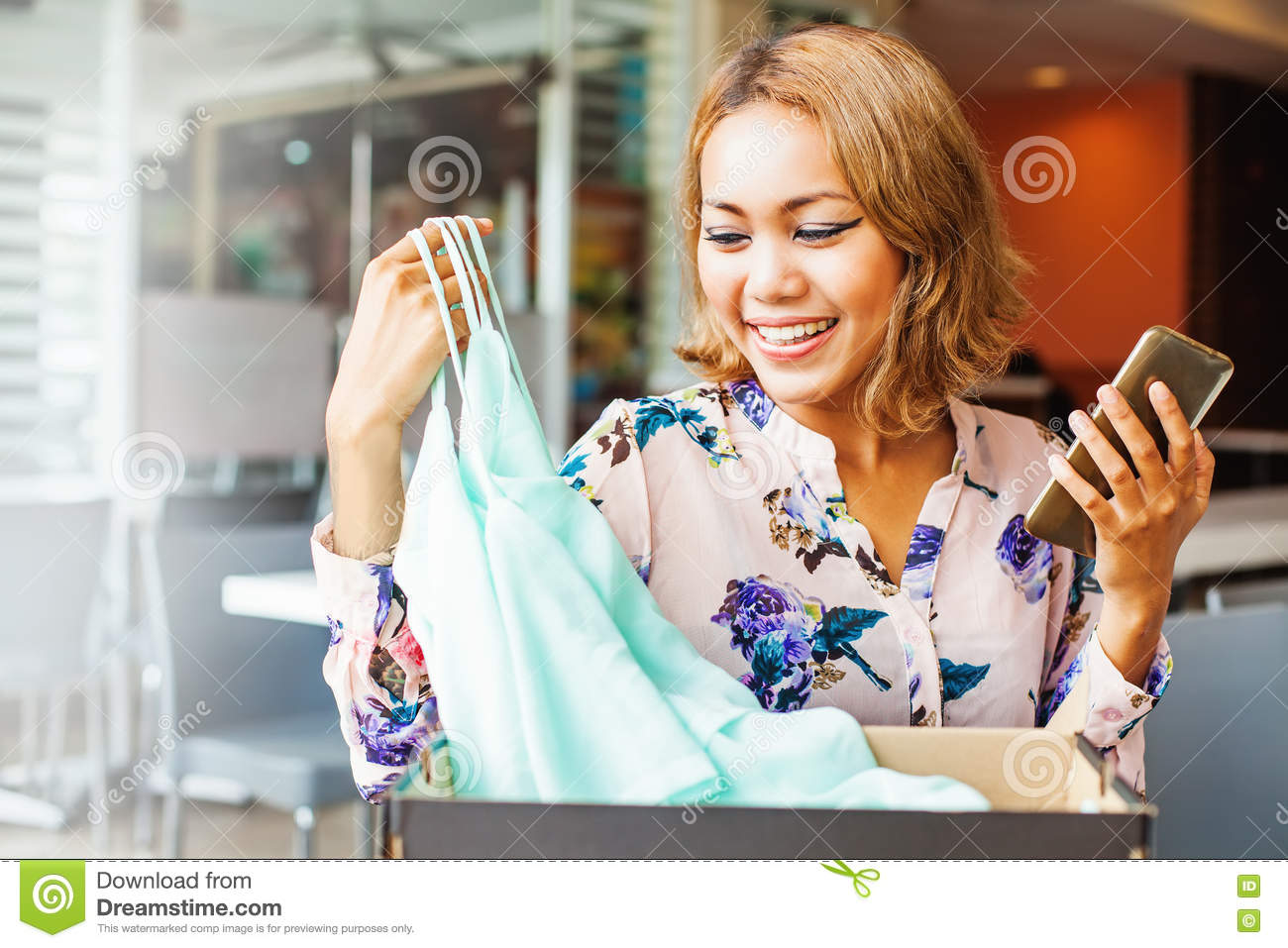 Woman looking at clothes she got from online store