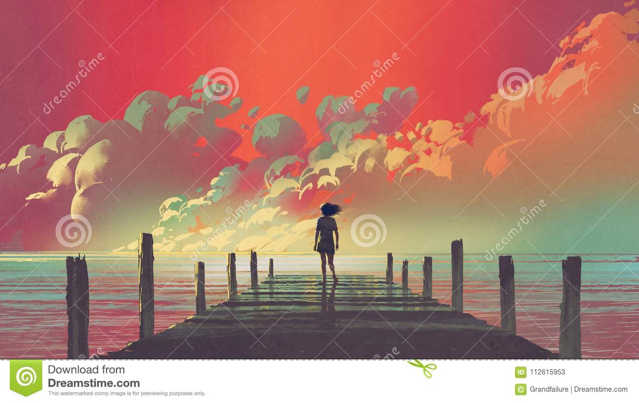 Woman looking at colorful clouds in the sky