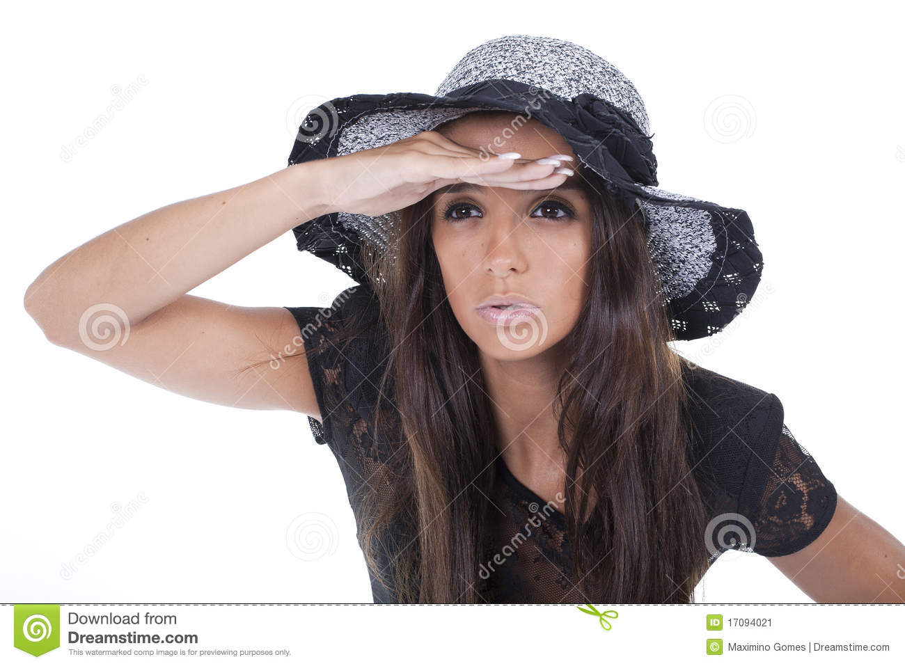 Young and beautiful woman looking far ahead with a hat on