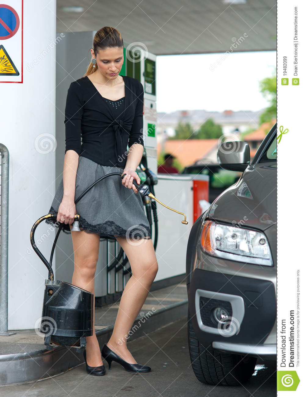 Woman looking at flat tire royalty free stock images image 19482099