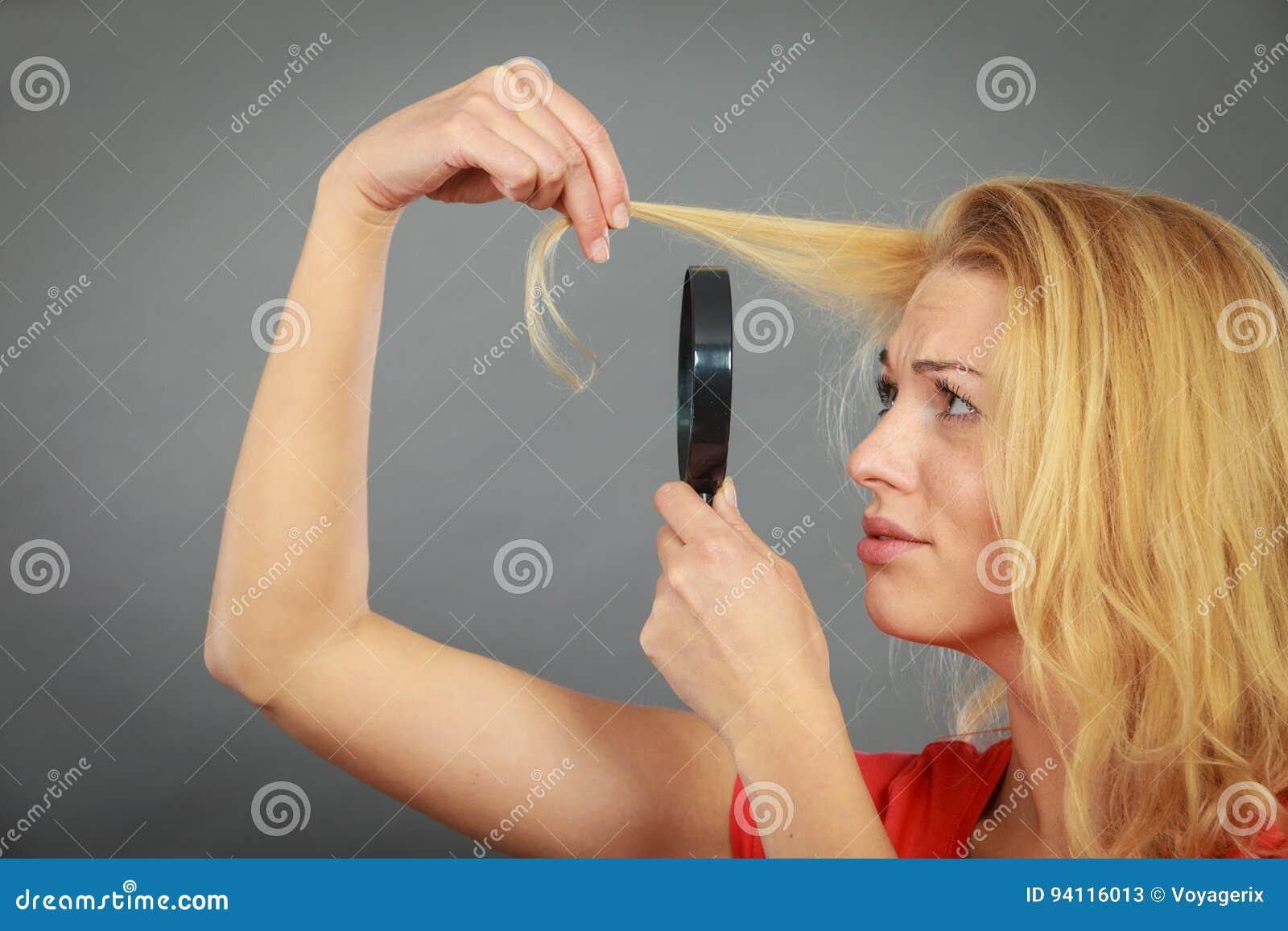 Thumbs through her hair