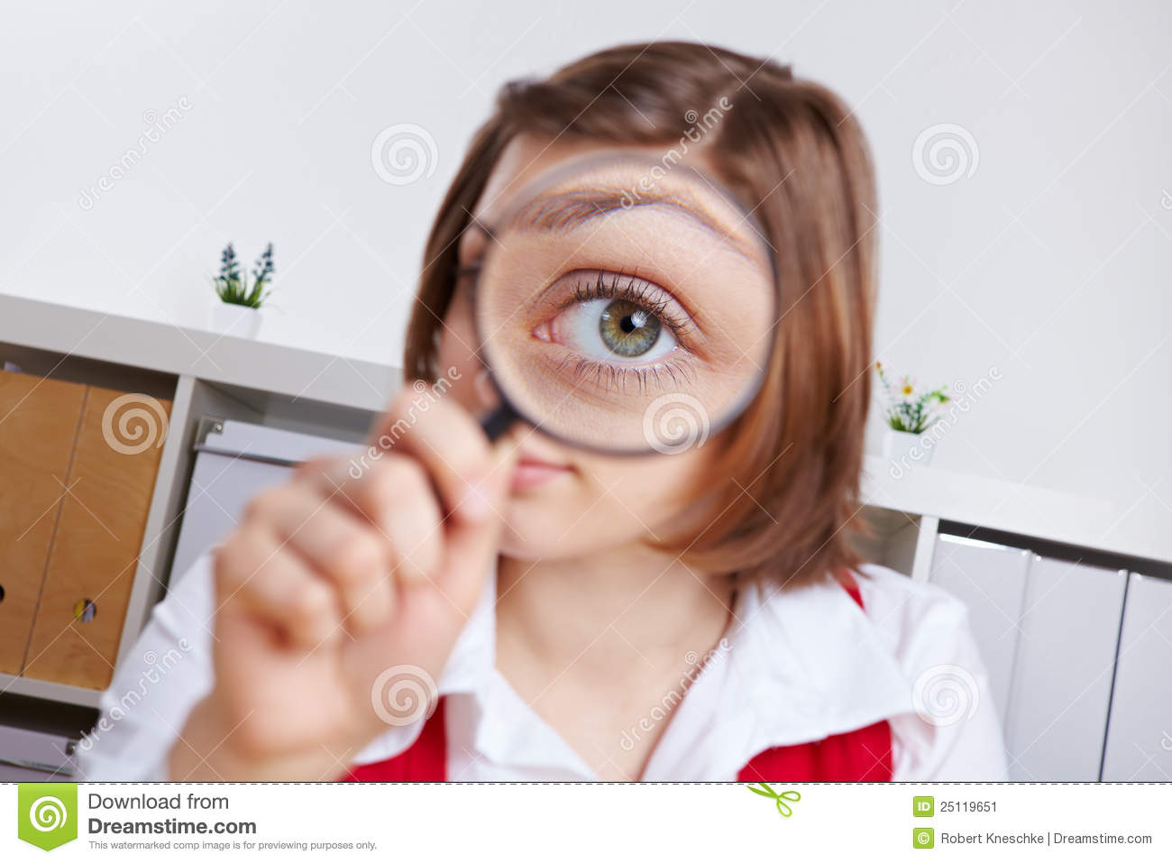 Woman Looking Through Magnifying Stock Image