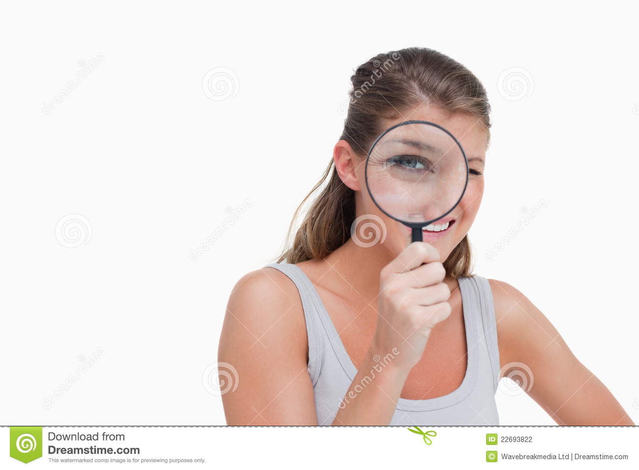 Woman Looking Through A Magnifying Glass Royalty-Free