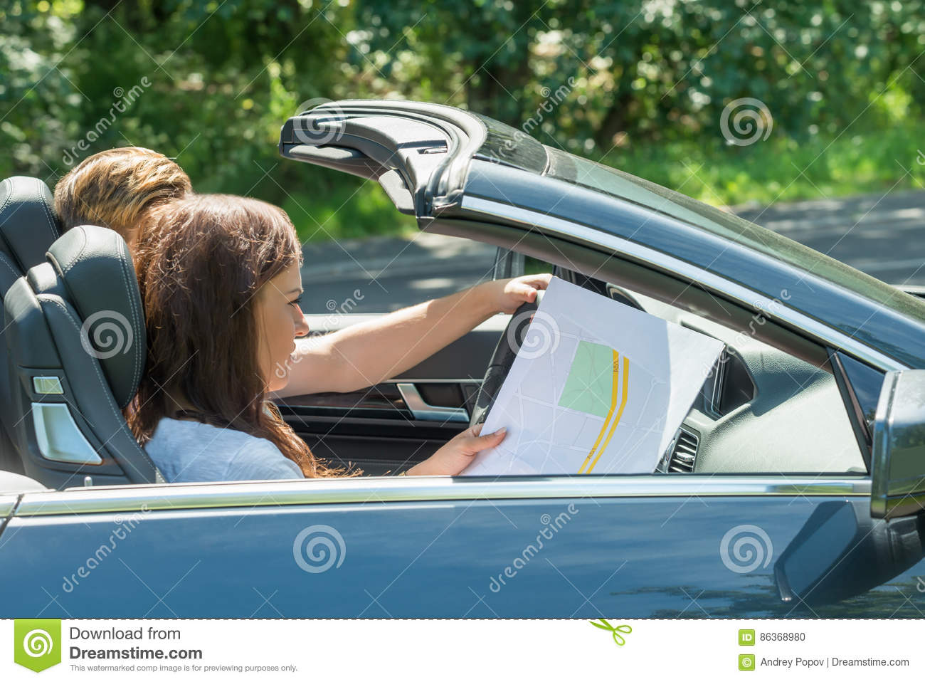 Woman Looking At Map While Man Driving Car Stock Photo ... on maps of city arlington va, maps to print, maps satellite view, maps app icon, maps location history, maps travel directions, mapquest map, maps of only india physical, map it, city maps, maps and directions, maps teaching directions, travel directions, travel maps, maps get directions, basic map directions, maps on canvas, maps for kindergarten, maps street view, online maps, road map with directions, maps to color, print maps with directions, road maps, get directions, street maps, satellite maps, maps with driving directions, maps showing directions, mapquest directions, city street maps, maps with street names,