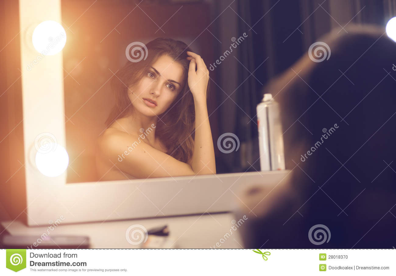Woman looking into a mirror stock photo image 28018370 for Looking mirror