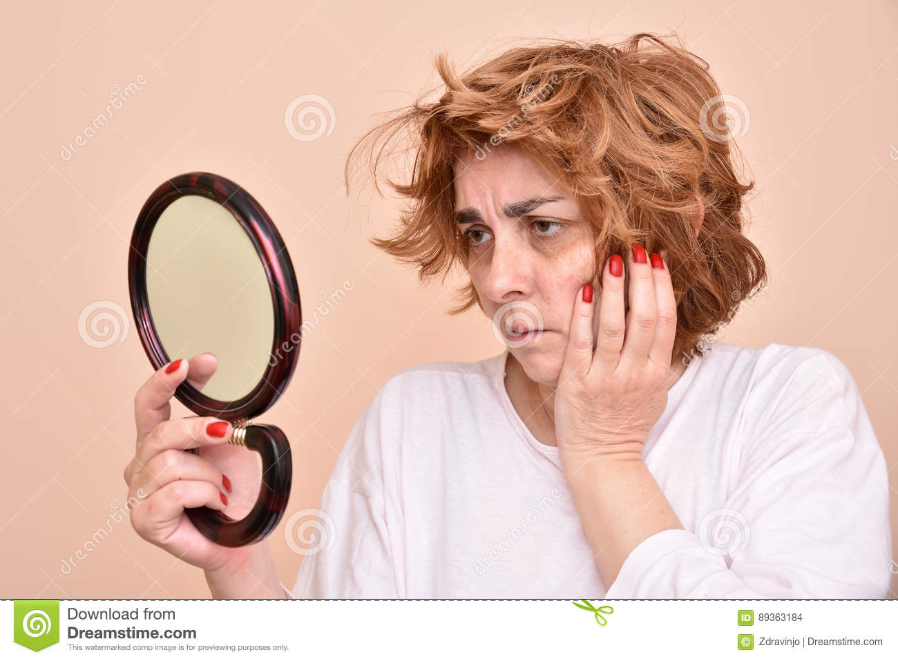 Woman looking at the mirror