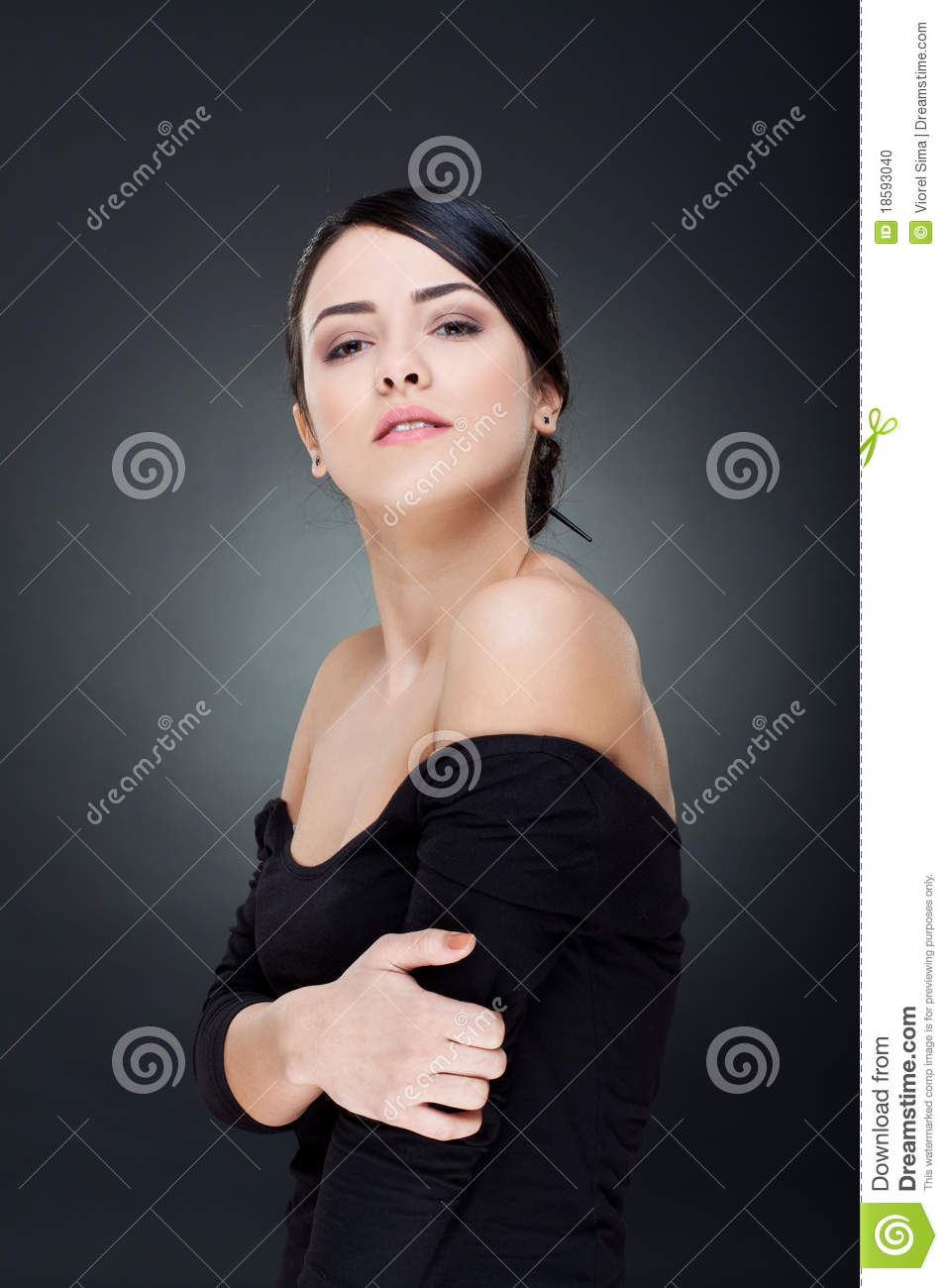 Woman Looking Over Her Shoulder Stock Photo - Image: 18593040