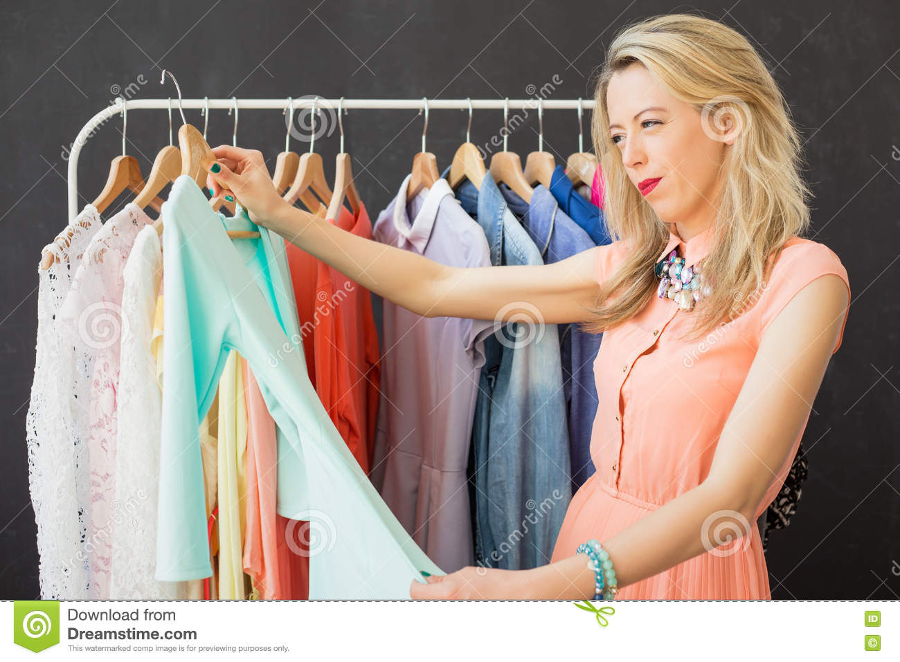 Woman looking at piece of clothing