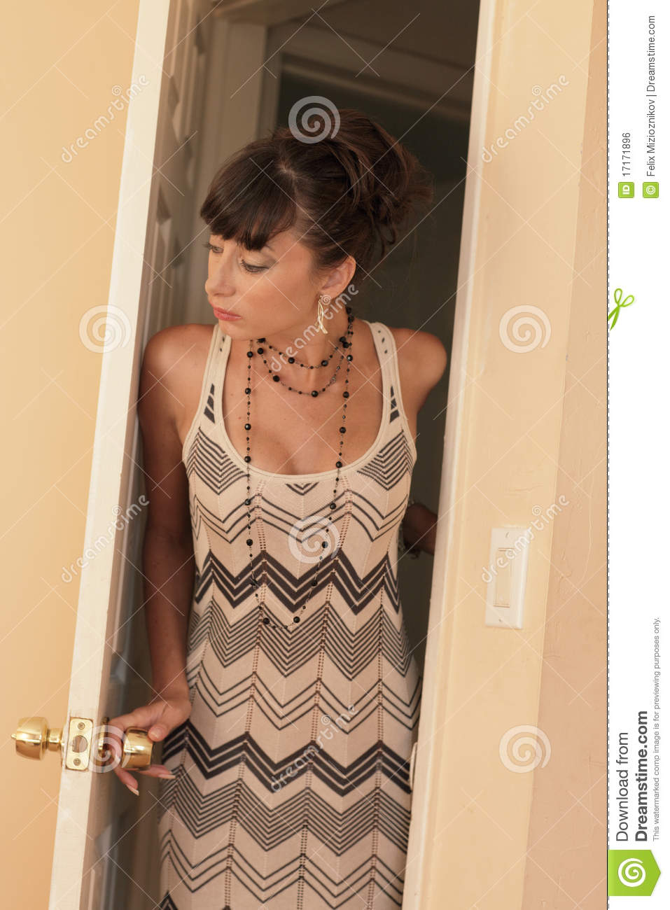 Woman Looking Into A Room Royalty Free Stock Image