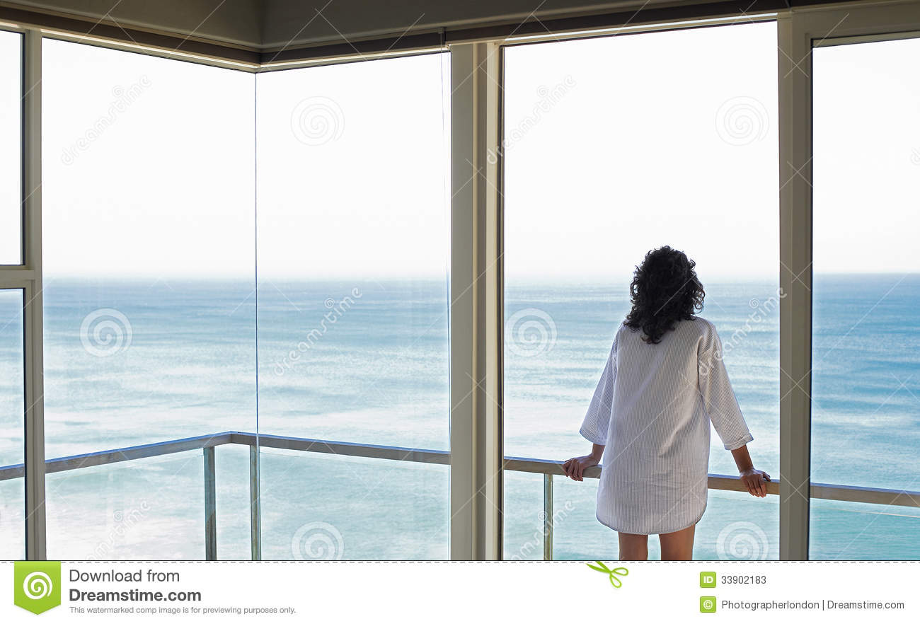Woman looking at sea view from balcony stock image image for Balcony surrounds