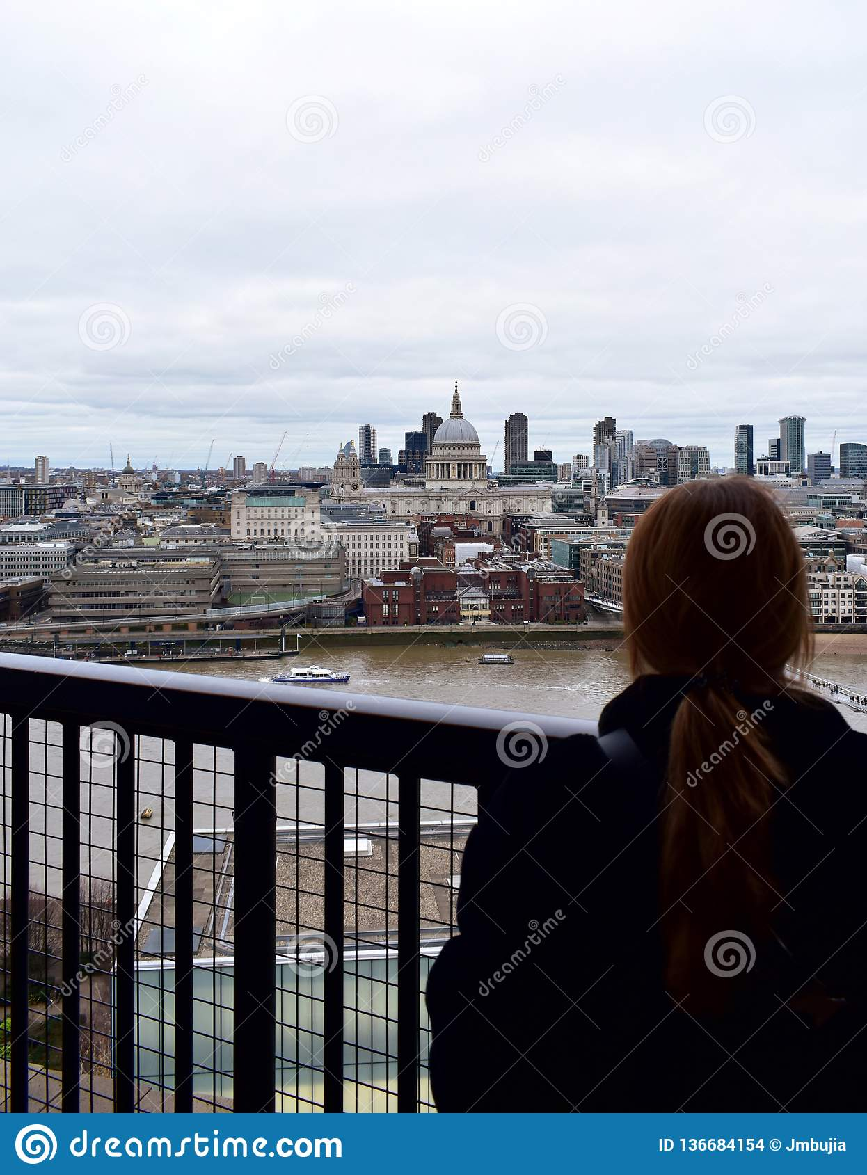 Woman Looking At St Pauls Cathedral From Tate Modern Lookout