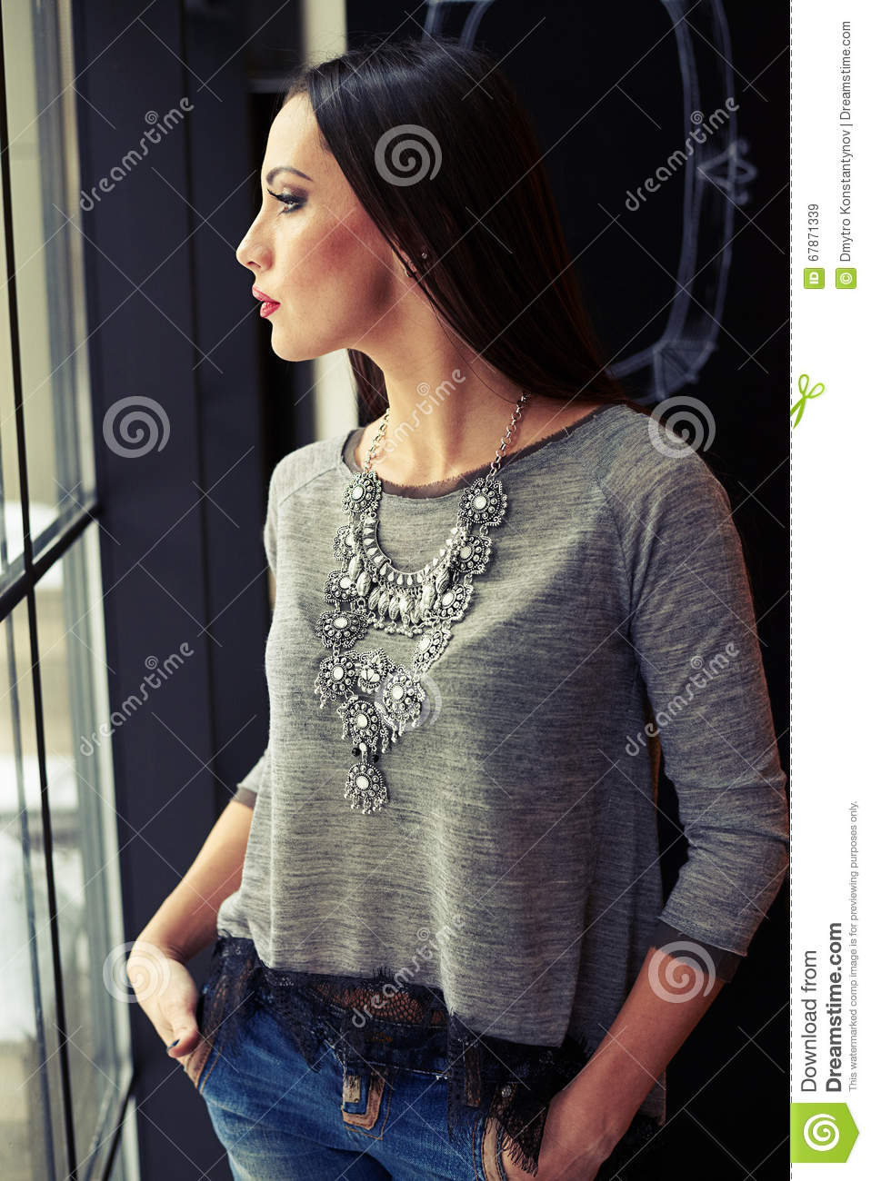 Woman looking to the window