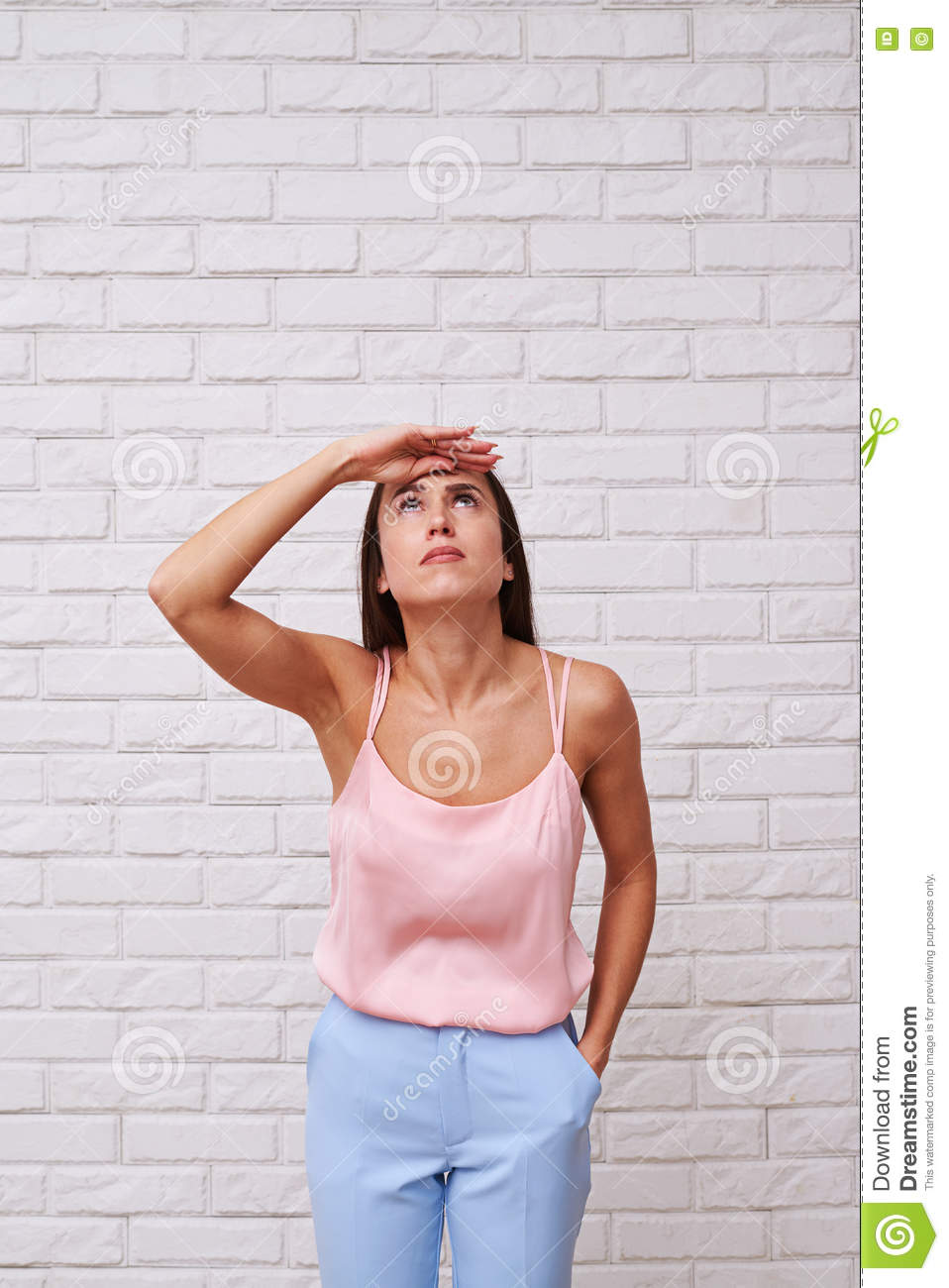 A woman looking up, having an eager eyes