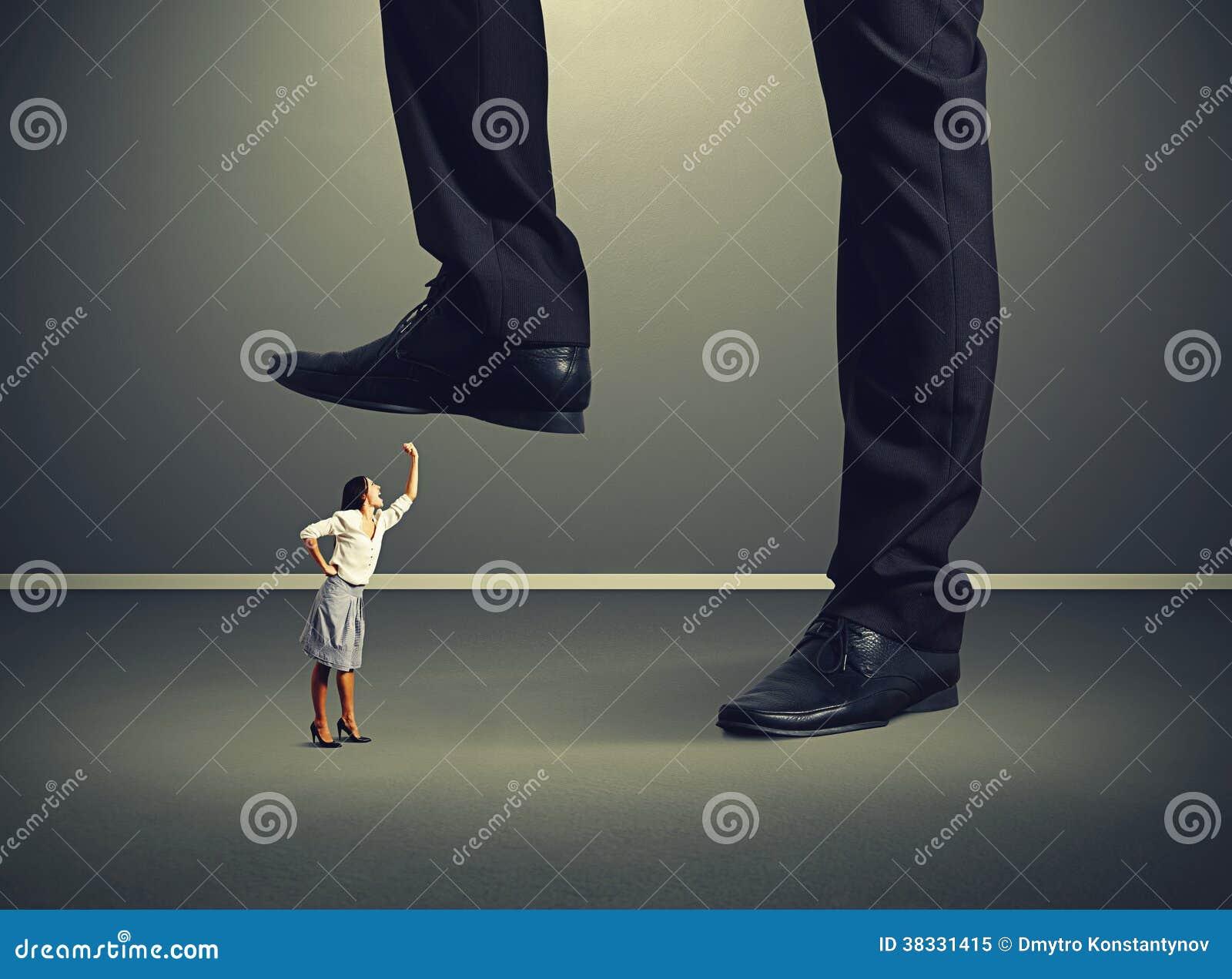 Woman looking up and screaming at big boss