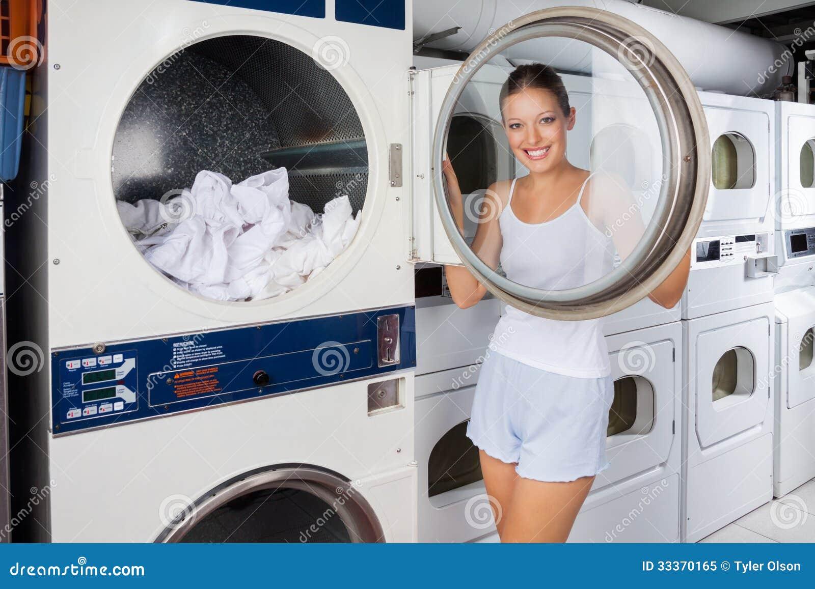Coin Washing Machine >> Woman Looking Through Washing Machine Lid Royalty Free ...
