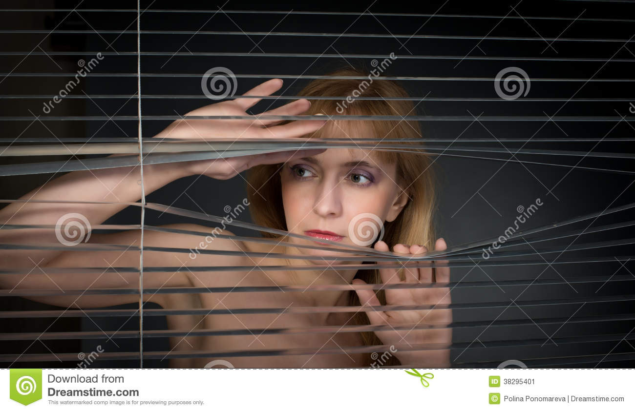 Woman Looking Through Window Blinds Stock Image Image