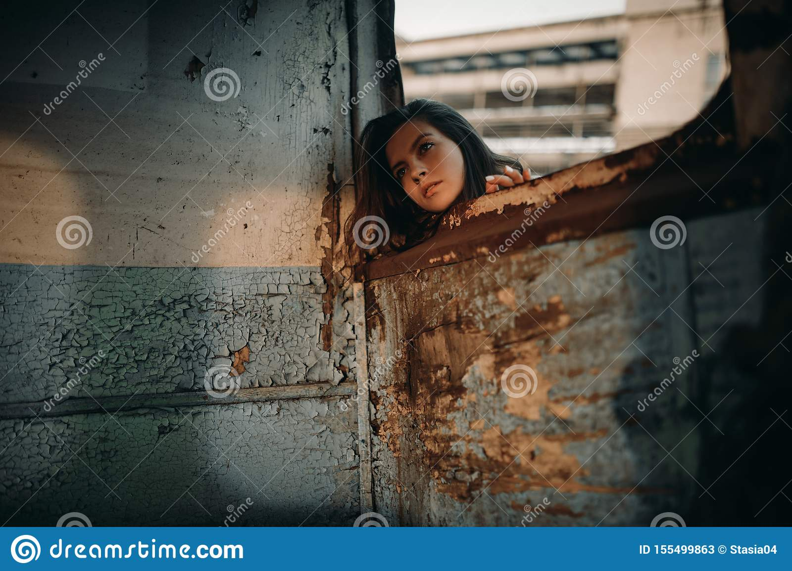Woman looks out window of abandoned ship