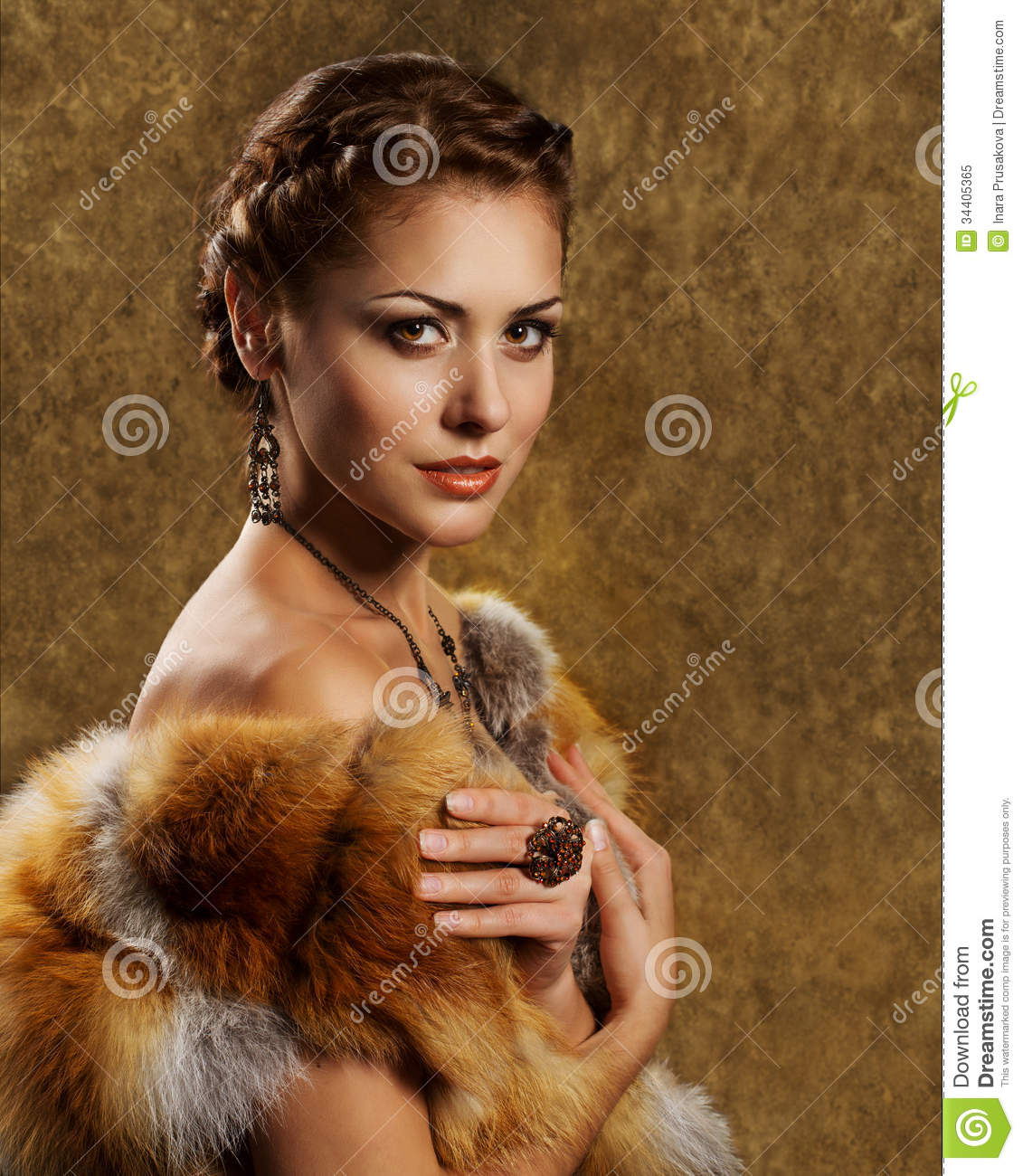 Woman in luxury golden fox fur coat retro style stock for Luxury women